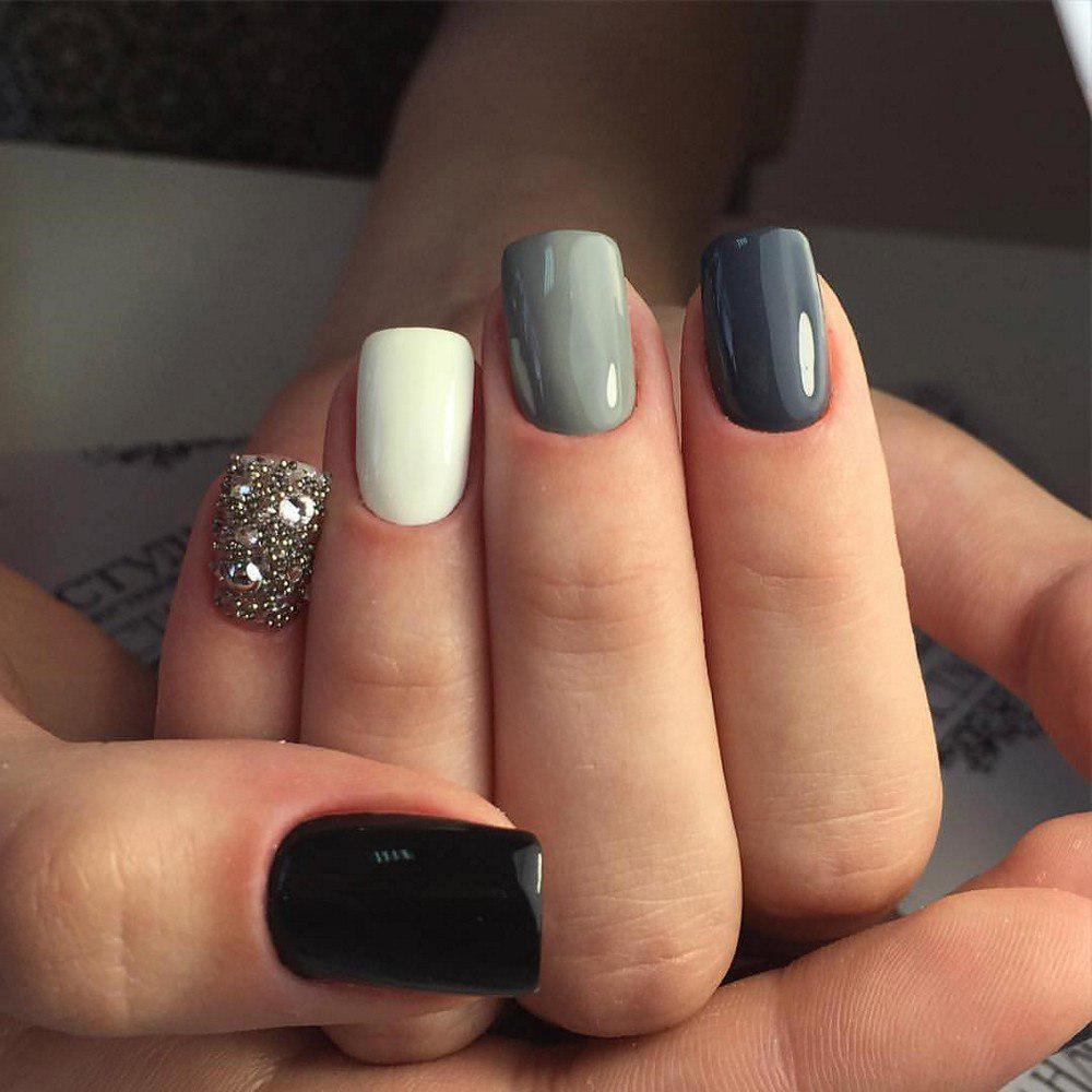 А вязаный маникюр серого цвета, который можно увидеть на фото, наоборот укутает своей теплотой и нежностью.